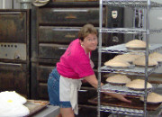 Kathy browning the meringue on some cream pies